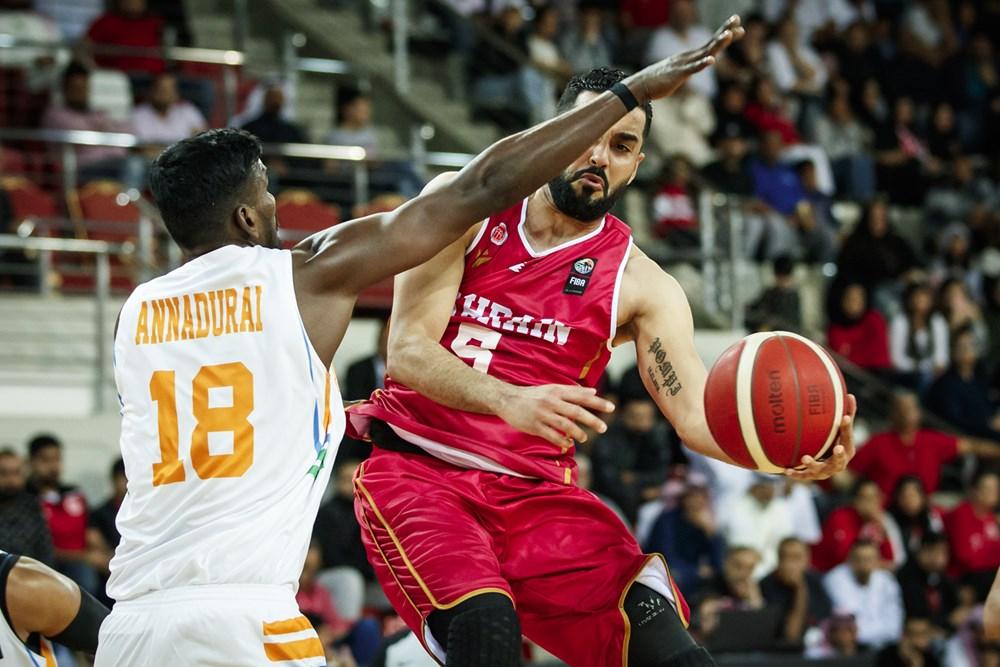 Aravind Annadurai looks to cut off Bahrain's attack in the FIBA Asia Cup qualifiers