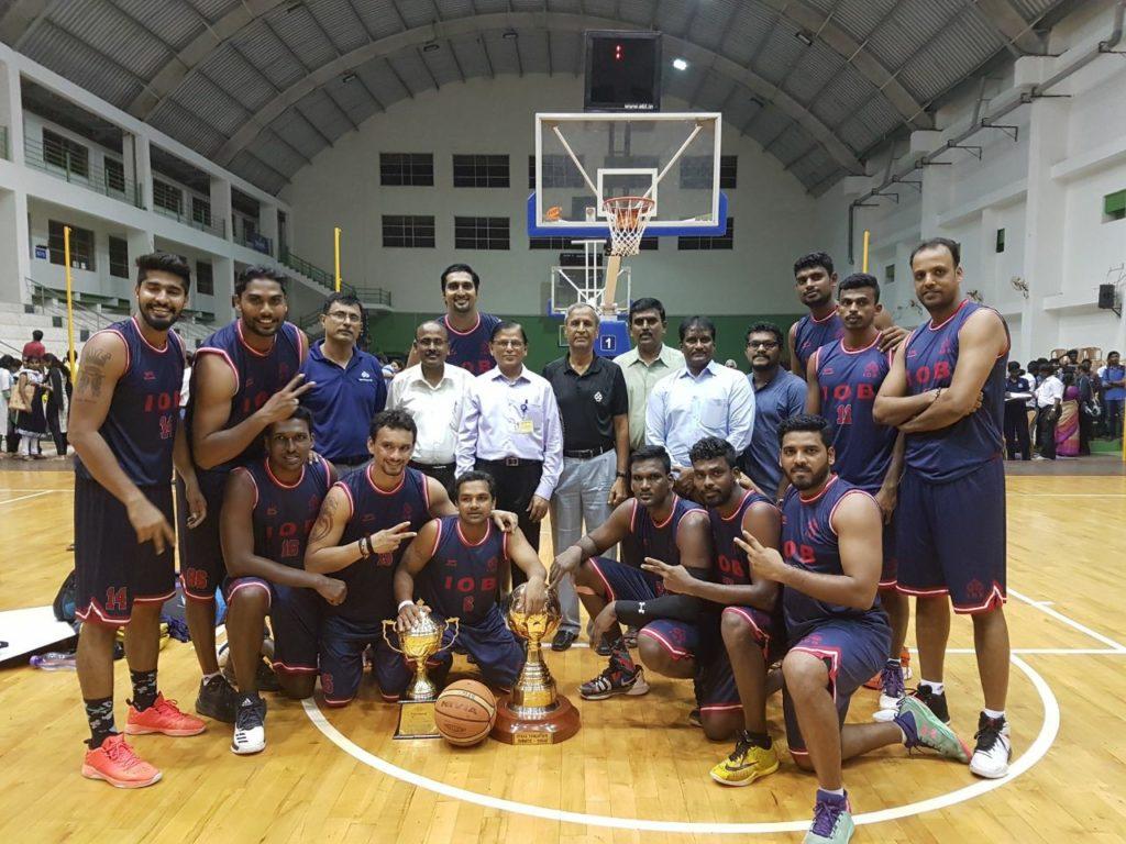Indian Overseas Bank (IOB) basketball team including Aravind Annadurai, Mihir Pandey, Rikin Pethani, Pratham Singh, Prasanna Venkatesh.